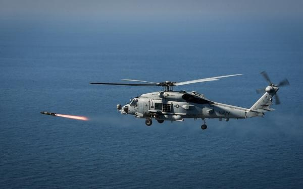 A U.S. Navy MH-60R Sea Hawk helicopter assigned to the Spartans of Helicopter Maritime Strike Squadron 70 shoots an AGM-114N Hellfire missile during the BALTOPS exercise on June 14. (Mass Communication Specialist 1st Class Theodore Green/Navy)