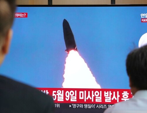 People watch a TV showing a file image of North Korea's missile launch during a news program at the Seoul Railway Station in Seoul, South Korea, Thursday, July 25, 2019. (Ahn Young-joon/AP)