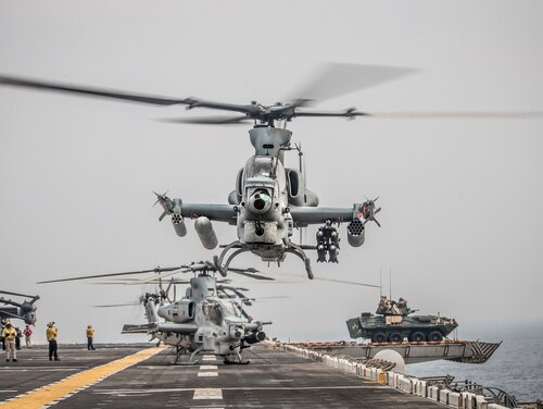 An AH-1Z Viper helicopter takes off Aug. 12, 2019, during a Strait of Hormuz transit aboard the amphibious assault ship Boxer . (Lance Cpl. Dalton S. Swanbeck/U.S. Marine Corps)