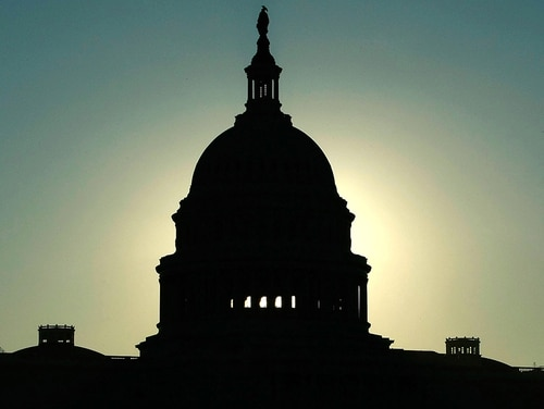 The early morning sun rises behind the U.S. Capitol building Oct. 20, 2008, in Washington, DC. (Mark Wilson/Getty Images)