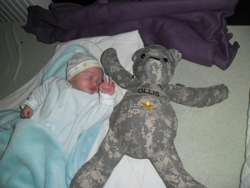Newborn baby Michael Cierpica lies with a teddy bear made from the Army fatigues of Staff Sgt. Michael Ollis, the soldier from New Dorp who sacrificed his life saving the infant's father during an attack in Afghanistan. (Photo courtesy of Ollis family)