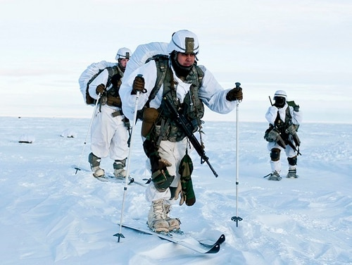 Paratroopers with U.S. Army Alaska's 4th Infantry Brigade Combat Team (Airborne), 25th Infantry Division ski across the drop zone during Exercise Spartan Pegasus. Army researchers are working on a coating to keep troops warm while cutting down on layers. (Staff Sgt. Daniel Love/Army)
