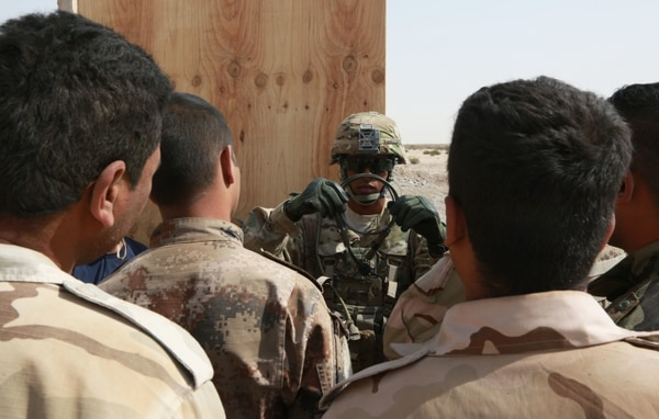 A U.S. Army Soldier assigned to the 1st Battalion, 32nd Infantry Regiment, 1st Brigade Combat Team, 10th Mountain Division, teaches Iraqi soldiers how to properly tie a knot, during the engineer course at the Besmaya Range Complex, Iraq, Oct. 14, 2015. The Iraqi soldiers attending the course were the first receiving training to become combat engineers. Through advise and assist and build partner capacity missions, the Combined Joint Task Force – Operation Inherent Resolve's multinational coalition trains Iraqi security force personnel to defeat the Islamic State of Iraq and the Levant. (U.S. Army photo by Spc. Lakendra Stevens/Released)