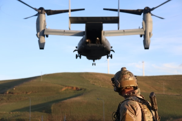 An Air Force pararescue jumper attached to Special Purpose Marine Air-Ground Task Force-Crisis Response-Africa 19.1 rehearses hoist-rescue operations on and off an MV-22 Osprey at Naval Air Station Sigonella, Italy, Dec. 20, 2018. (Lt. Christin St. John/ Marine Corps)