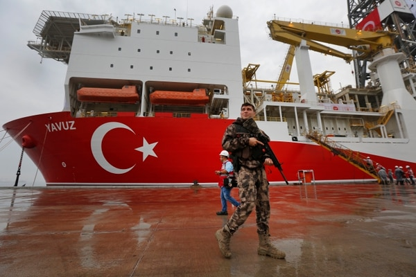 On June 20, a Turkish police officer patrolled the dock in front of the drilling ship Yavuz at the port of Dilovasi. (Lefteris Pitarakis/AP)