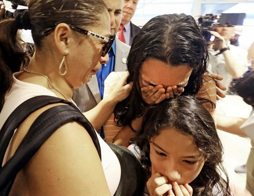 Alejandra Juarez,38, left, says goodbye to her children, Pamela and Estela at the Orlando International Airport on Friday, Aug. 3, 2018 in Orlando, Fla. Juarez, the wife of a former Marine, is preparing to self-deport to Mexico in a move that would split up their family. (Red Huber/Orlando Sentinel via AP)