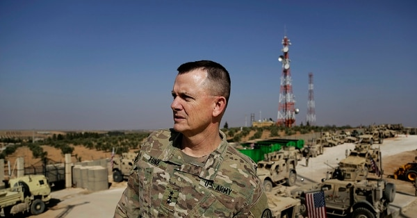 U.S. Army Lt. Gen. Paul E. Funk speaks to the Associated Press at an American outpost in the northern Kurdish town of Manbij, Syria, Wednesday, Feb. 7, 2018. The top U.S. general in the coalition fighting the Islamic State group pledged American troops would remain in the town despite Ankara's demands for a U.S. pullout. (Susannah George/AP)