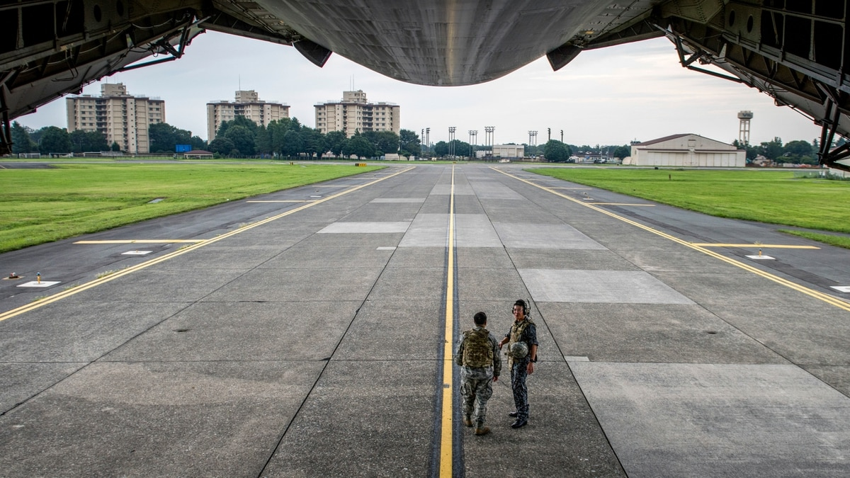 On the ground at Yokota Air Base, the Air Force transport