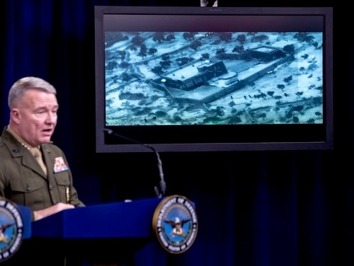 Video of the Abu Bakr al-Baghdadi raid is displayed as U.S. Central Command Commander Marine Gen. Kenneth McKenzie speaks, Wednesday, Oct. 30, 2019, at a joint press briefing at the Pentagon in Washington. (Andrew Harnik/AP)