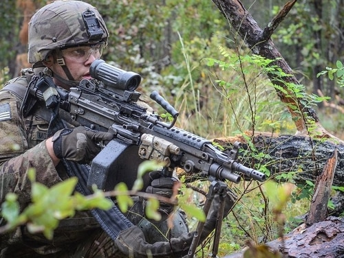 A paratrooper with the 82nd Airborne Division scans his lane for a simulated enemy during a squad-level live fire exercise. (Army)