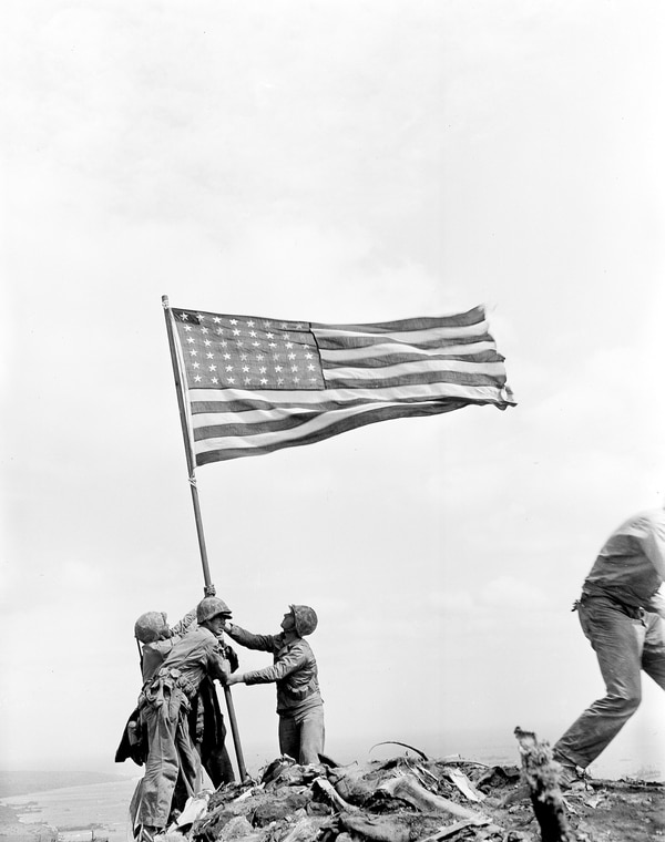 U.S. Marines of the 28th Regiment of the Fifth Division raise the American flag after capturing the 550-foot Mt. Suribachi on Iwo Jima, the largest Volcano Islands of Japan, on Feb. 23, 1945 during World War II. (Joe Rosenthal/AP)