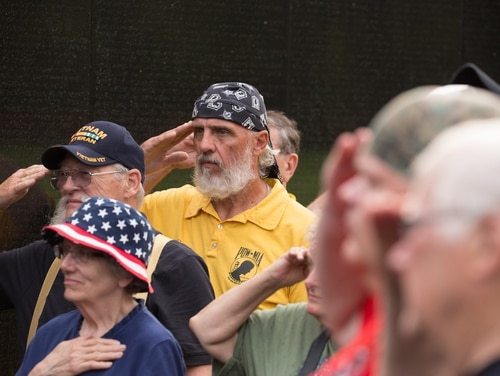 Volunteers gather at the Vietnam Veterans Memorial in Washington, D.C., for a clean-up event on June 2, 2018. (Gene Russell/VA)