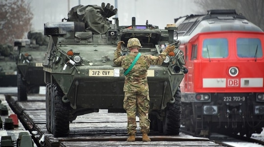 2nd Cavalry Regiment soldiers load Stryker Fighting Vehicles on rail cars at Rose Barracks' railhead station in Vilseck, Germany, in 2016. (U.S. European Command)