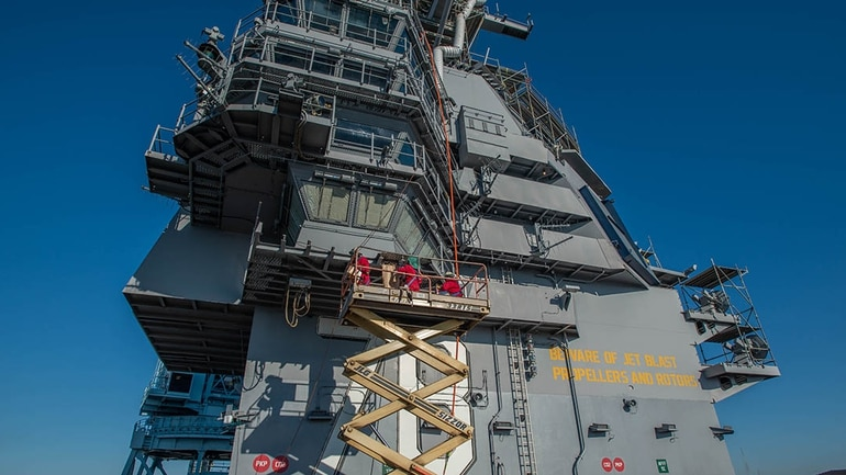 The island of the next-gen carrier Gerald R. Ford gets worked on by shipyard workers. (Mark D. Faram/Staff)