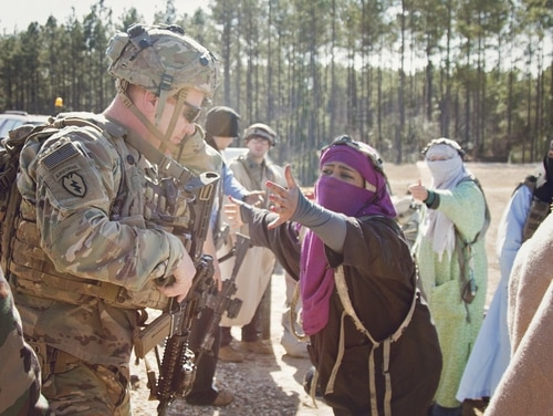 An officer speaks to local Afghan role players during 1st SFAB's Joint Readiness Training Rotation at Fort Polk, Louisiana. (Staff Sgt. Sierra Melendez/Army)