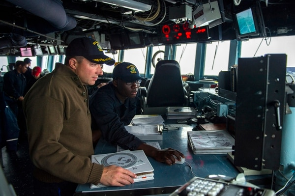 150515-N-UN259-089 EAST CHINA SEA (May 15, 2015) Cmdr. Jeffery Heames, commanding officer of the Arleigh Burke-class guided-missile destroyer USS Preble (DDG 88), discusses course corrections with Quartermaster Seaman Jeffrey Mensa. Preble is deployed to the 7th Fleet area of operations in support of security and stability in the Indo-Asia-Pacific region. (U.S. Navy photo by Mass Communication Specialist Seaman Alonzo M. Archer/Released)
