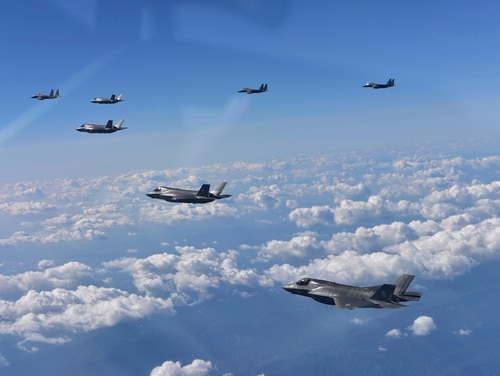 U.S. Air Force F-35 stealth fighters and South Korean F-15 fighter jets fly over South Korea in August. Six U.S. F-22 Raptors and 18 F-35 Lightning IIs are taking part in the Vigilant Ace exercise over the Korean Peninsula.