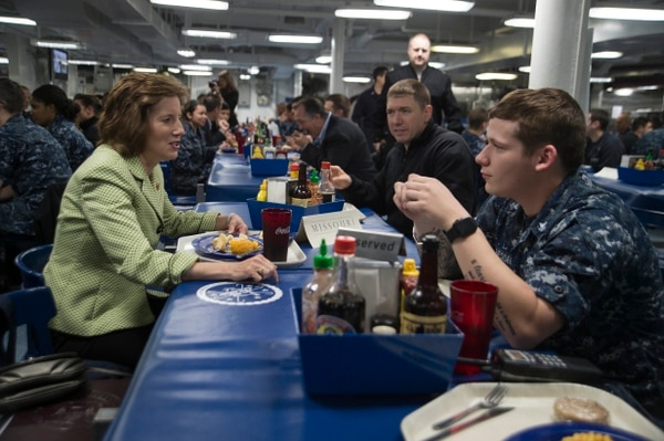 Rep. Vicky Hartzler, left, eats lunch with U.S. Navy sailors on the mess decks aboard the aircraft carrier Dwight D. Eisenhower. The congresswoman from Missouri is concerned about the Navy's aircraft inventory. (Seaman Apprentice Joshua Murray/U.S. Navy)