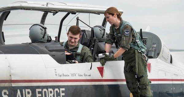 Airman First Class Tyler Haselden, Pilot Training Next student, and Maj. Rachel Rehurek, an instructor pilot, prepare for a training flight at Austin-Bergstrom International Airport in Austin, Texas June 22. (Sean Worrell/Air Force)