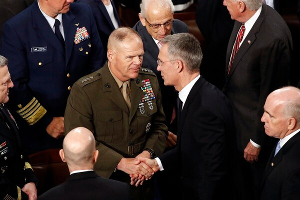 Marine Corps Commandant Gen. Robert Neller, left, speaks with NATO Secretary-General Jens Stoltenberg after Stoltenberg addressed a joint meeting of Congress on Capitol Hill in Washington, Wednesday, April 3, 2019. (Patrick Semansky/AP)