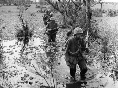Marines on patrol in Vietnam in March 1967. James Stogner, the fourth Marine in the patrol, was awarded the Navy Cross for heroism during the Vietnam War. (Courtesy photo)