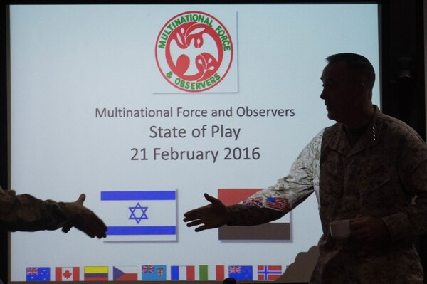 U.S. Chairman of the Joint Chiefs of Staff, Marine Gen. Joseph F. Dunford Jr., introduces himself to members of the Multinational Forces Observers (MFO) before a brief near the Sinai border in Egypt, Feb. 21, 2016. The Multinational Force and Observers (MFO) is an international peacekeeping force overseeing the terms of the peace treaty between Egypt and Israel. (DoD photo by D. Myles Cullen/Released)