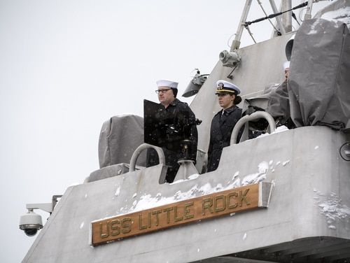 The Blue crew of the LCS Little Rock man the rails during the ship's commissioning ceremony Dec. 16, 2017, in Buffalo, New York. The ship has been marooned in Montreal, Canada, since Dec. 27, and the Navy says they'll be there indefinitely because of icy conditions. (photo courtesy of Lockheed Martin/Navy)