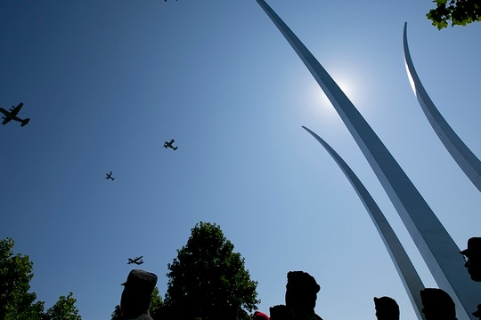 A missing man formation flies over the Air Force Memorial during a Medal of Honor unveiling ceremony for Air Force combat controller Technical Sgt. John Chapman, who was posthumously awarded the Medal of Honor on Wednesday. (Alan Lessig/Staff)