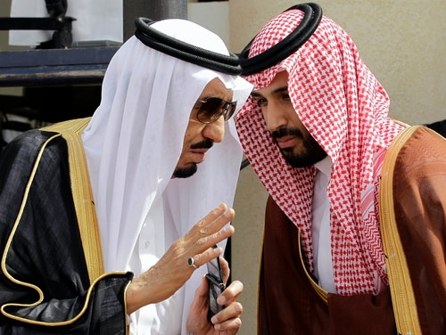 Then-Crown Prince Salman, left, speaks with his son, Prince Mohammed, on May 14, 2012, in Riyadh, Saudi Arabia. The kingdom has replaced its military chief of staff and other defense officials amid its stalemated war in Yemen early Feb. 27, 2018. (Hassan Ammar/AP)