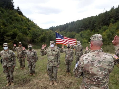 Soldiers from the U.S. Army National Guard and U.S. Army Reserve participate in a reenlistment ceremony Sept. 26, 2020, near Ferizaj/Urosevac, Kosovo. (Spc. Miguel Ruiz/Army National Guard)