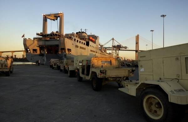 A line of U.S. Army Humvees waits on a dock at the Port of Savannah, Ga., in 2003. The USNS Mendonca was being loaded with military hardware bound for the Arabian Gulf. (Stephen Morton/Getty Images)