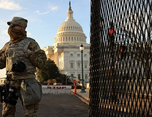 A member of the New York National Guard stands at a gate outside the U.S. Capitol on Jan. 14, 2021, the day after the House of Representatives voted to impeach President Donald Trump for the second time. (Chip Somodevilla/Getty Images)