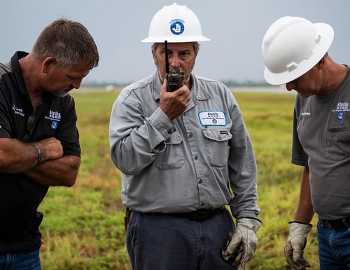 Tim Lewis, Frank Cutchens and John Dunham, J&J Worldwide Services base operations personnel, work with the 325th Civil Engineer Squadron and other base agencies on flightline lighting at Tyndall Air Force Base, Florida, June 6. (Airman 1st Class Bailee Darbasie/Air Force)