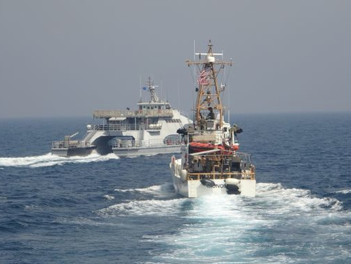 Iran's Islamic Revolutionary Guard Corps navy Harth 55, left, conducted an unsafe and unprofessional action by crossing the bow of the Coast Guard patrol boat Monomoy April 2 as the U.S. vessel was conducting a routine maritime security patrol in international waters of the southern Arabian Gulf. (Navy)