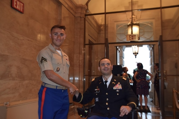 Cpl. Colm Grove, Marine Corps Base Quantico, welcomes retired Army Capt. Luis Avila as he enters the U.S. Capitol. Avila, a member of the Wounded Warrior Project was invited to tour the Capitol and watch the July 4, 2019, celebrations from the Speaker's Balcony. (Kristine Froeba)