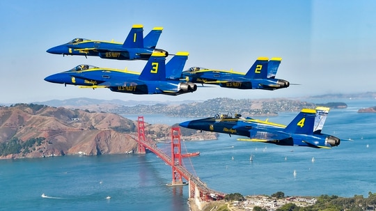 The U.S. Navy Flight Demonstration Squadron, the Blue Angels, diamond pilots fly over San Francisco on Oct. 11 during the 2019 San Francisco Fleet Week Air Show. (Mass Communication Specialist 2nd Class Timothy Schumaker/Navy)