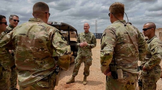 U.S. Army Brig. Gen. Damian Donahoe, deputy commanding general of Combined Joint Task Force–Horn of Africa, center, talks with service members during a battlefield circulation Sept. 5 in Somalia. (Senior Airman Kristin Savage/Air Force via AP)