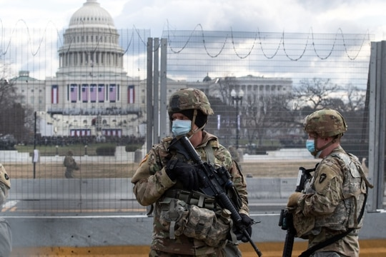 National Guard troops patrol the vicinity of the U.S. Capitol hours before the Inauguration of President Biden in Washington on Jan. 20, 2021. (Roberto Schmidt/AFP via Getty Images)