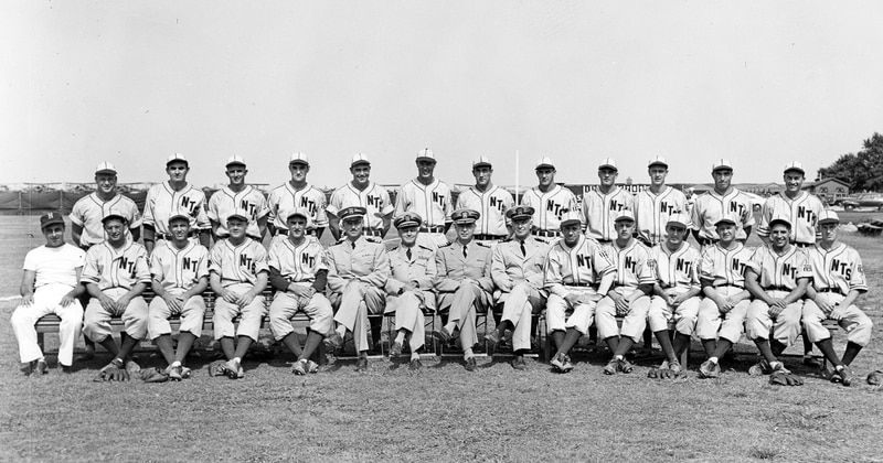 The 1943 Bluejackets appear in a team portrait with Capt. Henry McClure and Manager Gary Bodie. Robinson is on second row, fifth from left. (Courtesy of Sargeant Memorial Collection, Norfolk Public Library)