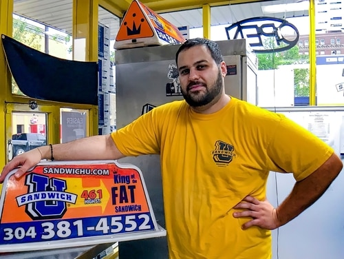 This April 2017, file photo photo shows George Tanios at his sandwich shop in Morgantown, W.Va. U.S. officials have arrested and charged Tanios and a Pennsylvania man with assaulting U.S. Capitol Police officer Brian Sicknick with bear spray during the Jan. 6, 2021, riot in Washington. (Andrew Spellman/The Daily Athenaeum via AP)