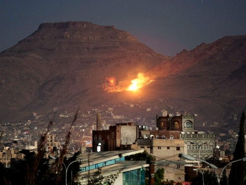 Fire and smoke rise after a Saudi-led airstrike hit a site believed to be one of the largest weapons depots on the outskirts of Yemen's capital, Sanaa, in October 2016. The Pentagon earlier this year initiated an operation to support Saudi Arabia and other partner nations operating in Yemen. (Hani Mohammed/Associated Press)