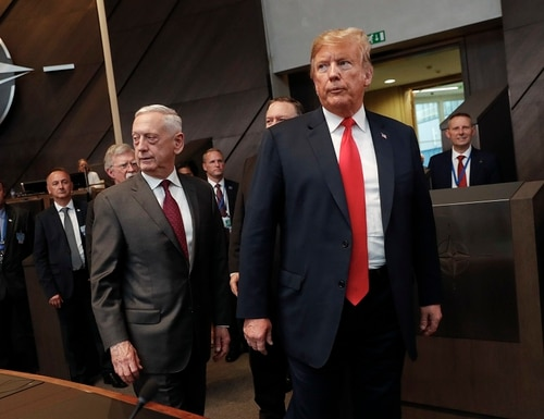 U.S. President Donald Trump, right, walks in with Defense Secretary Jim Mattis, left, as they arrive to attend the multilateral meeting of the North Atlantic Council, Wednesday, July 11, 2018 in Brussels, Belgium. (Pablo Martinez Monsivais/ AP)