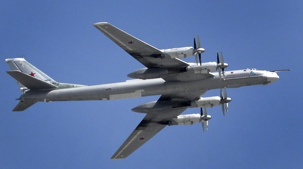 A Russian Tupolev Tu-95 turboprop-powered strategic bomber flies above the Kremlin in Moscow, on May 7, 2015, during a rehearsal for the Victory Day military parade. A strategic bomber with seven people on board crashed in far eastern Russia on July 14 but its crew apparently managed to parachute out and a search for them was underway, the defence ministry said. AFP PHOTO / ALEXANDER NEMENOV (Photo credit should read ALEXANDER NEMENOV/AFP/Getty Images)