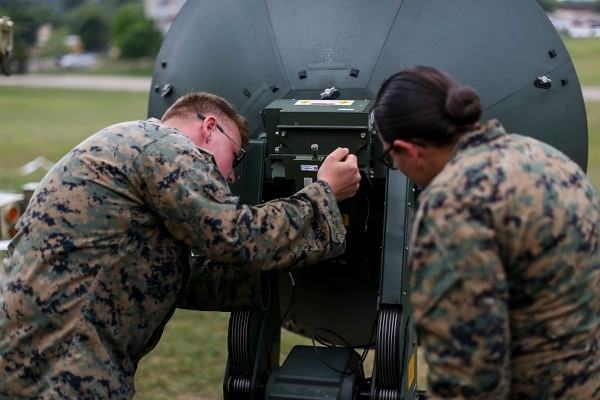 Marines with Marine Aircraft Group 13 work on communications equipment during Exercise Northern Lightning at Volk Field Counterland Training Center, Camp Douglas, Wis. (Sgt. David Bickel/Marine Corps)
