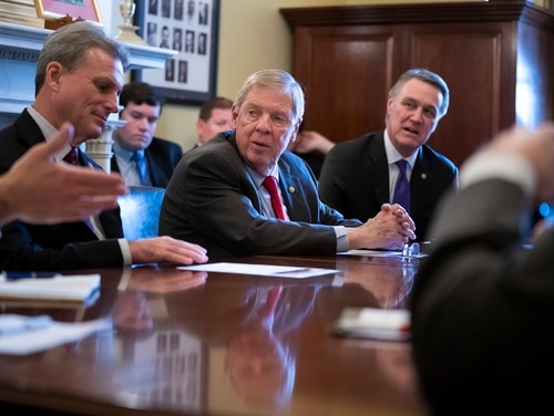 Sen. Johnny Isakson, R-Ga. (center), and congressional colleagues meet with Georgia officials during a Capitol Hill meeting on Feb. 14, 2019. Isakson, the current chairman of the Senate Veterans' Affairs Committee, is set to retire at the end of 2019. (J. Scott Applewhite/AP)