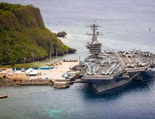 The U.S. Navy aircraft carrier Theodore Roosevelt is moored pierside at Naval Base Guam on May 15, 2020. (MC3 Conner D. Blake/U.S. Navy)