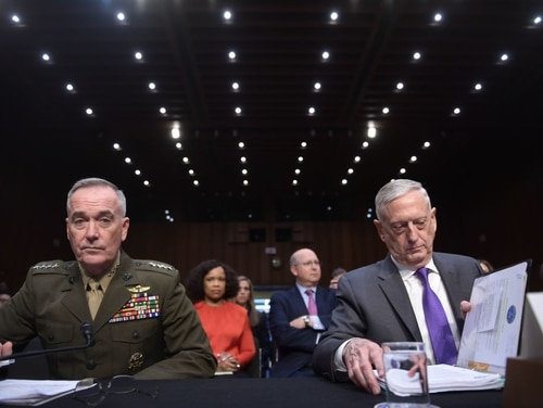 Joint Chiefs of Staff Chairman Gen. Joseph F. Dunford Jr., left, has offered military support to defend election infrastructure, according to a top lawmaker. (Brendan Smialowski/AFP/Getty Images)