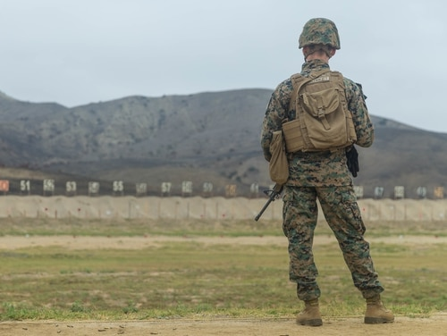 Marine Corps Sgt. Dayton Greenwalt, platoon sergeant, Marine Wing Support Squadron 372, Marine Aircraft Group 39, 3rd Marine Aircraft Wing, waits for his shot to be scored down range at Wilcox Rifle Range, Marine Corps Base Camp Pendleton, California, Sept. 20. (Lance Cpl. Kerstin Roberts/ Marine Corps)