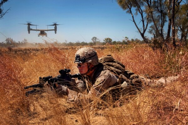 Lance Cpl. John Ready, an M27 Infantry Automatic Rifle gunner for Company E., Battalion Landing Team 2nd Battalion, 4th Marines, 31st Marines Expeditionary Unit, provides security as an MV-22 Osprey from Marine Medium Tiltrotor Squadron 265 (Reinforced), 31st MEU, takes off after inserting a platoon of Marines during an integrated, live-fire exercise for Exercise Koolendong 13 here, Sept. 3. The 31st MEU moved a battalion-sized force more than 300 miles inland to conduct the training. The exercise demonstrates the operational reach of the 31st MEU and reinforces why the 31st MEU is the force of choice for the Asia-Pacific region. Also participating in the exercise is the Marine Rotational Force - Darwin and soldiers of the 5th Royal Australian Army. The 31st MEU brings what it needs to sustain itself to accomplish the mission or to pave the way for follow-on forces.