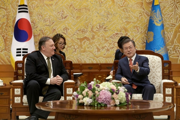 South Korean President Moon Jae-in, right, talks with U.S. Secretary of State Mike Pompeo during a meeting at the presidential Blue House in Seoul, South Korea, Sunday, Oct. 7, 2018. (Ahn Young-joon/Pool via AP)